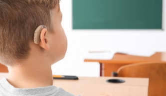 An image of a child wearing a hearing aid