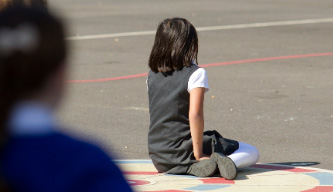 An image of a girl in the playground