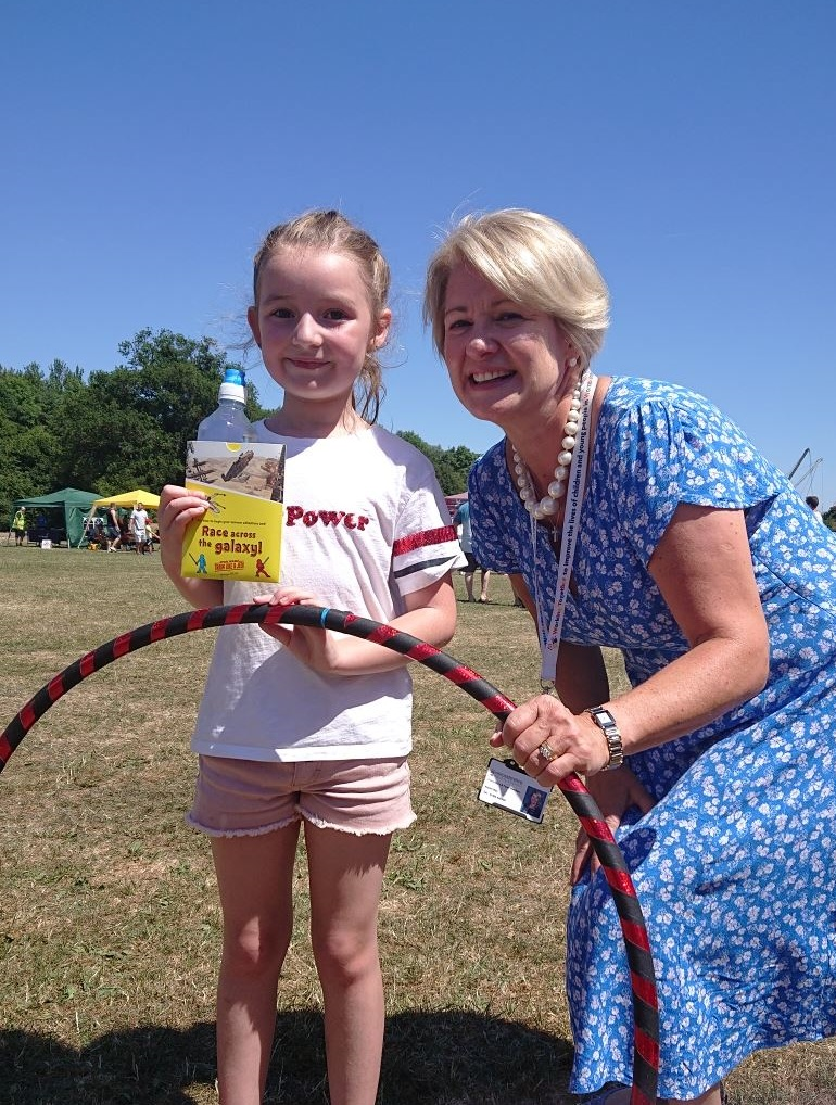 Councillor Karen May congratulates Maddie from Redditch for topping the leader board with the hoola hooping activity.