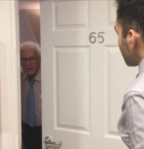 Man opens door and looks worried