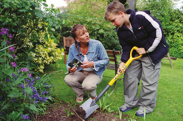 An image of a child and lady gardening