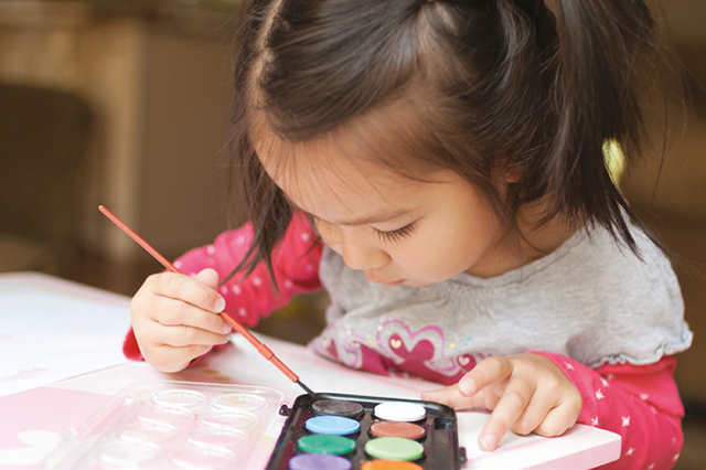 An image of a girl painting
