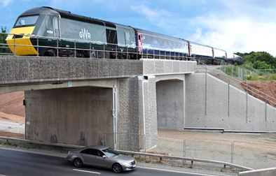 An image of a train passing over the new bridge on the A4440