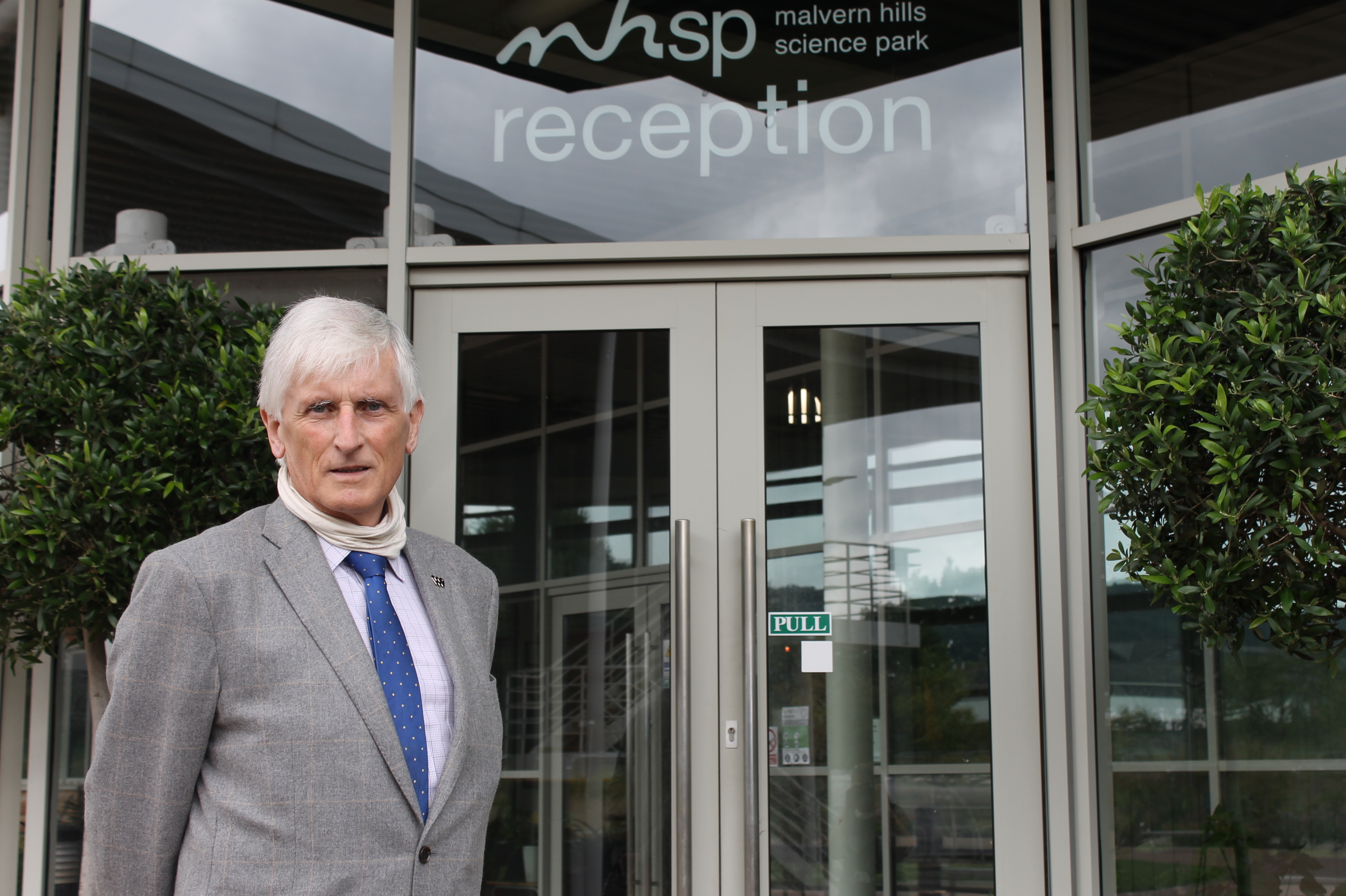 Councillor Ken Pollock standing outside Malvern Hills Science Park