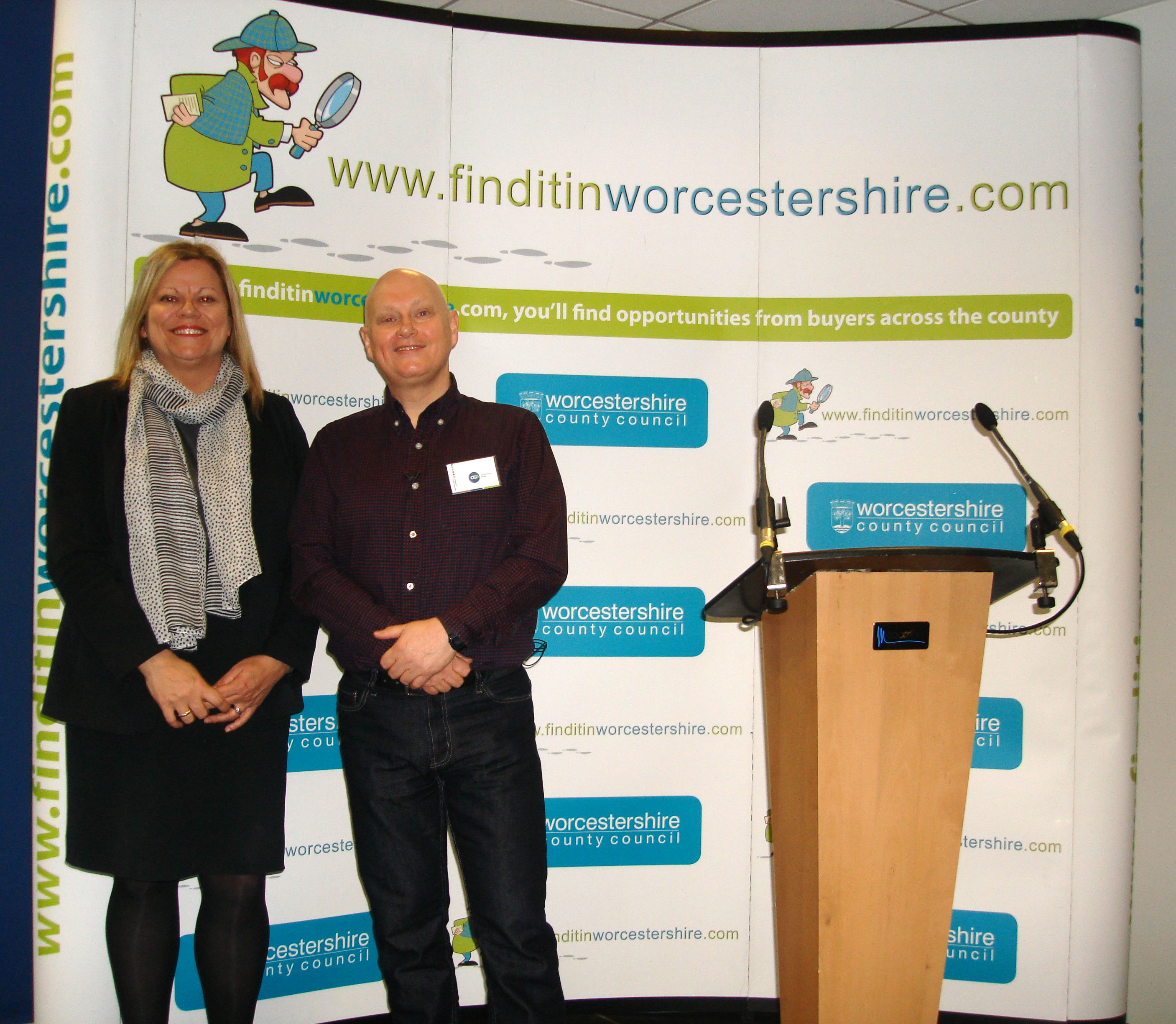 Sue Crow and Chris Green standing by the FinditinWorcestershire stand