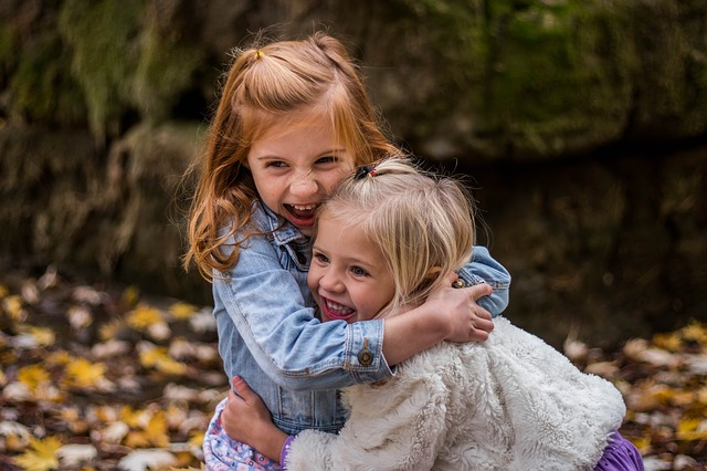 Fostering an image of two girls hugging