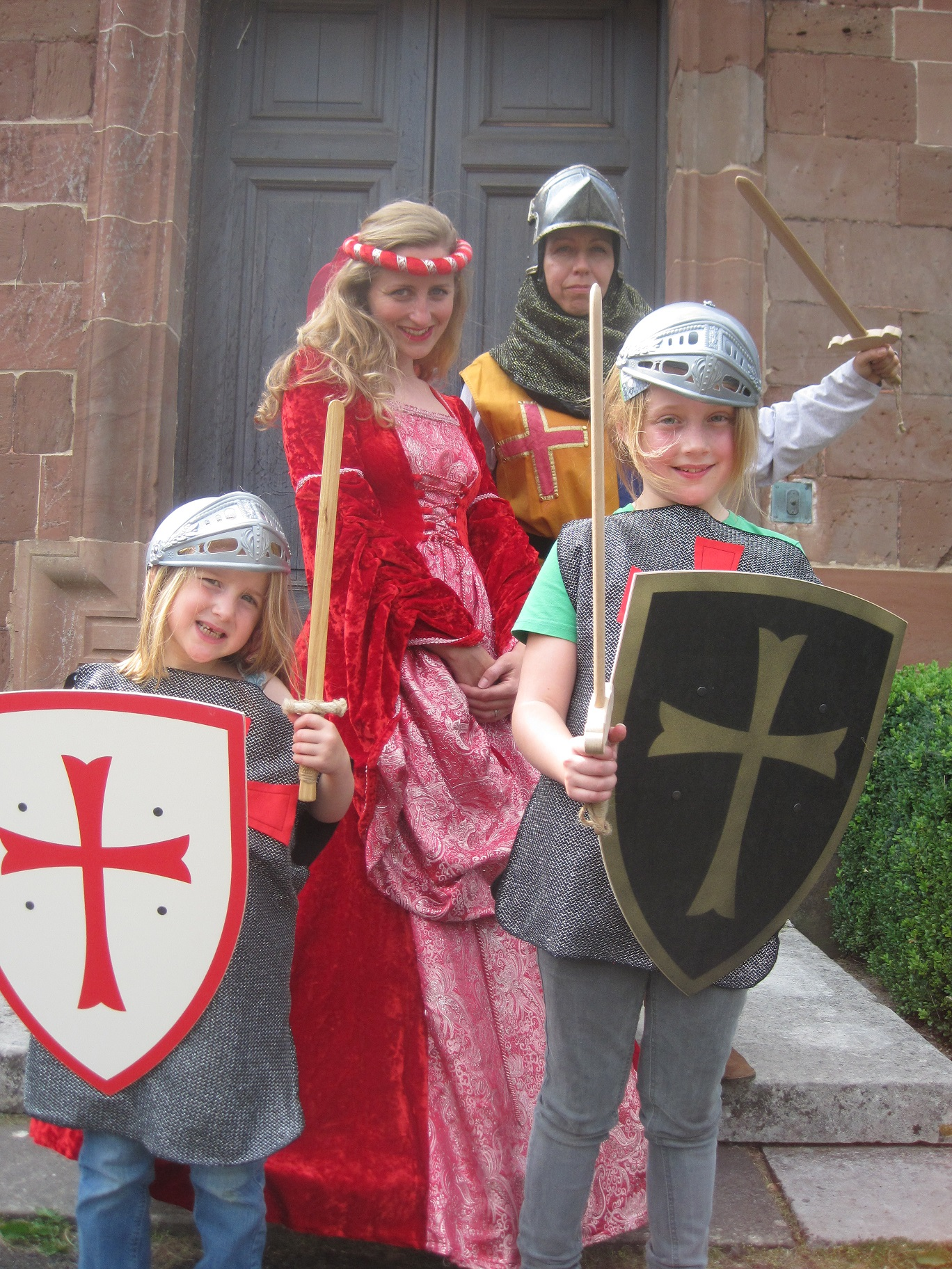Princess Poppy and Sir John, with their 'knights in training', Florence (5) and Morgan (9) Aspinall, from Hartlebury.