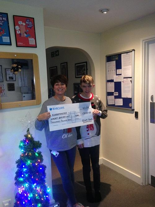 Dee Pryce and Jude Turbutt stand with a presentation cheque from the fundraiser at Moule Close