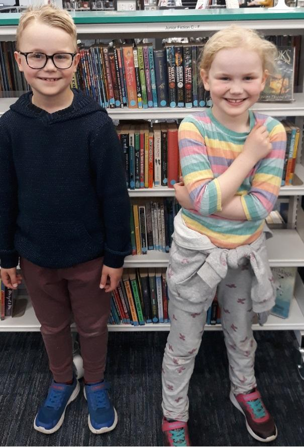 Austin and Constance Bennett pose at Redditch Library with new books.