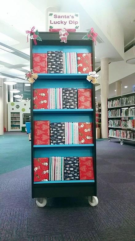 The Santa's Lucky Dip display at Bromsgrove Library, with pre-wrapped books for a borrowing surprise.