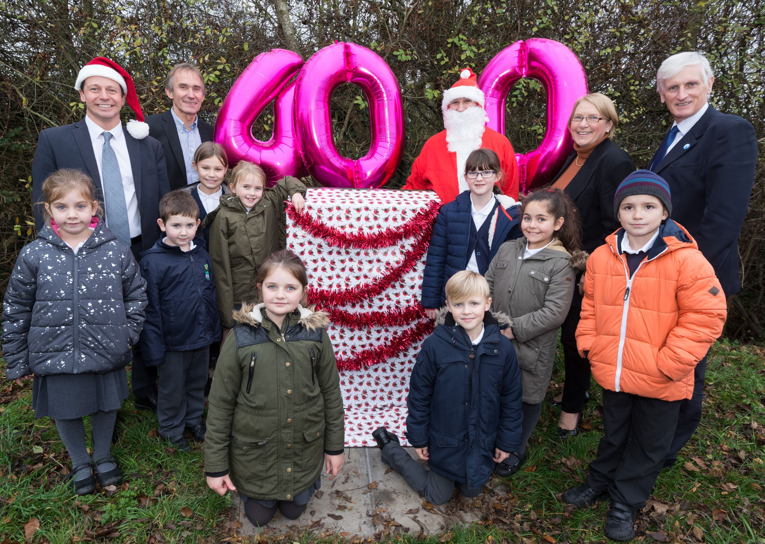 Photo, from left: Nigel Huddleston MP, Ian Binks (BT Group), Father Christmas, Cllr Liz Eyre and Cllr Ken Pollock with pupils from Broadway First School
