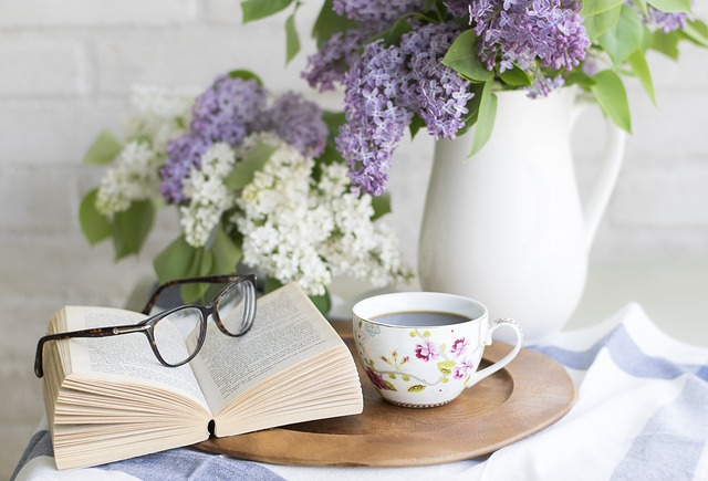 Support to stay at home - an image of a cup of coffee and a book
