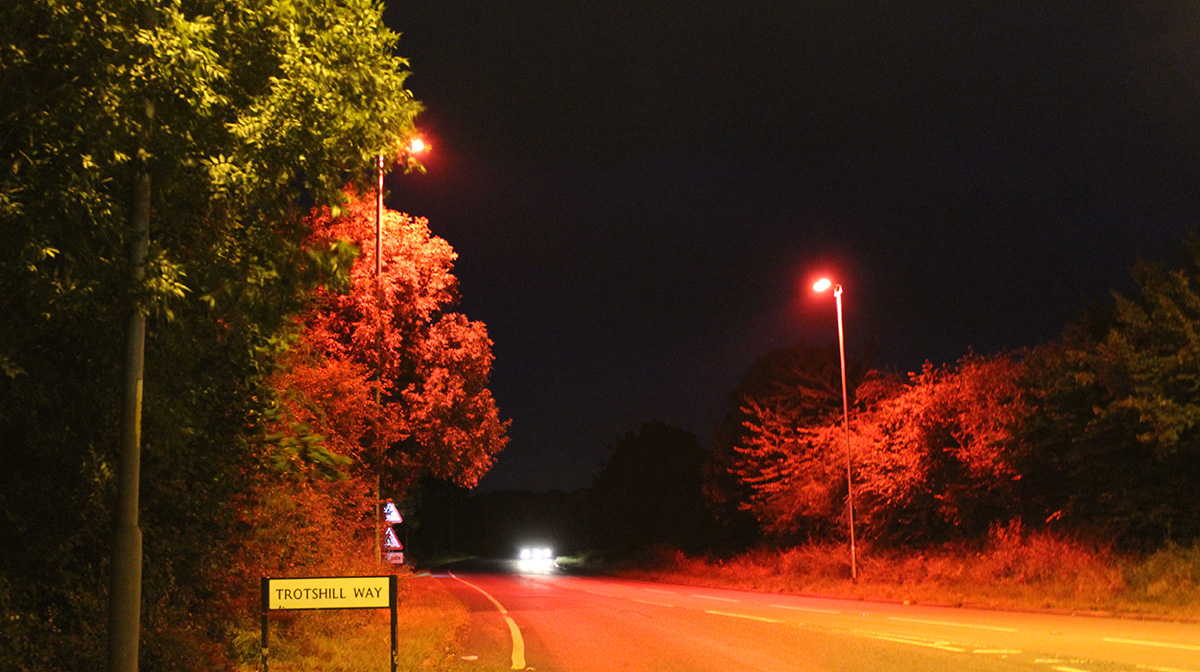 Trotshill Way lit up with red lighting