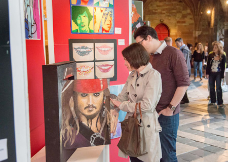 People browsing the 2014 Voices and Visions Art Exhibition in the Cloisters at Worcester Cathedral