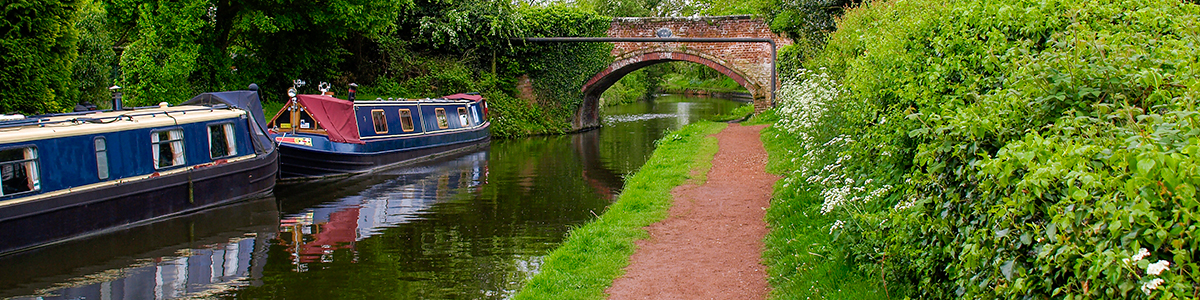 An image of a canal with a barge